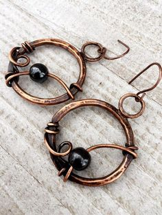 8mm hematite beads with antiqued,hammered and soldered 10 gauge copper wire. These earrings are sealed with protectaclear.