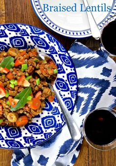 Braised lentils with herby vegetarian sausages, tomatoes, green peppers, bay and thyme - a delicious veggie recipe for a main or a side dish.