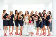 Ultra-Stylish Bridal Party  If you want your bridesmaids to wear the same dress, add a playful feel with look-at-me-accesories, like these hot pink pumps.