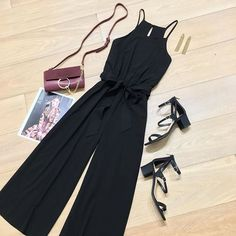 We are LOVING this flirty and effortless jumpsuit. Wear yours for your Valentine's Day plans. #blackjumpsuit #jumpsuitflatlay #jumpsuitoutfit