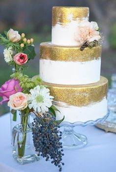 If you love all things sparkly and gold, you'll love this gilded cake by Amber McKenney of Sweet on Cake, who applied gold disco dust (an edible glitter made for cake decorating) to the fondant-covered tiers, giving it a painterly brushstroke effect.