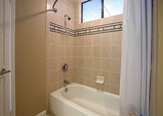 Grand Champions #45| Maui Hawaii Vacations Guest Bathroom with Combination tub and shower