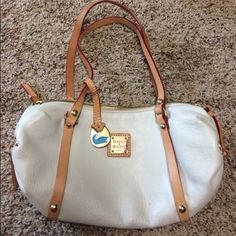 Dooney & Burke White Purse Cute purse, measurements are 11 inches long, about 6 inches height and 3 inches wide.  Purse is in excellent condition. Dooney & Bourke Bags