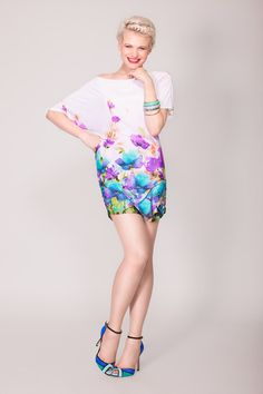 Tamra, off the shoulder dress/top in a stunning floral print  by Arzu Kara. Wear it as a dress if you want to show off your legs, whether permitting. Or wear it with capri pants for a more casual look.