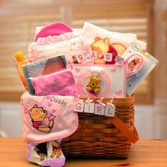 Winnie The Pooh New Baby Basket - Pink  Winnie The Pooh and you are sure to deliver sincere congratulations. This attractive woodchip hamper delivers an array of cozy Winnie the pooh gifts.