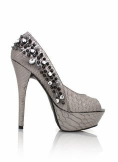 Most reptiles are swampy and filthy, but this reptile inspired heel is kind of glamorous.