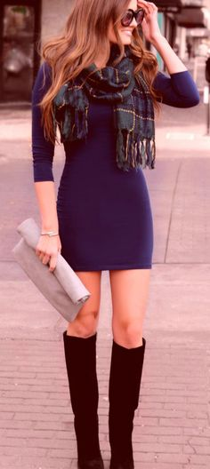 Navy blue body in dress with boots and scarf. Perfect for a winter reunion with old friends.