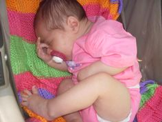 Pretty baby on pretty baby blanket  (knit 10, pearl 10, knit 10, pearl 10, repeat.  Change colors every 10 rows)