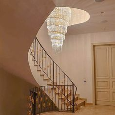 The stairwell (staircase) is often the centerpiece of every villa and therefore it is very important to choose functional but above all beautiful lighting. For this private villa in Cyprus we made a spiral shaped lamp with glass rods and crystal chains. The size has been specially adjusted to have a truly enlightening experience from every level of the house. 🌀 #inlovewithlight #crystalchandelier #lighting #bespoke #interiordesign #interiorlovers #interiordesigner#lightingdesigner Spiral Shape, Cyprus, Bespoke, Chains, Centerpiece, Beautiful Places, Villa, Homes, Interior Design