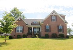 Reduced!! Seller now offering a Home Warranty on this beautiful all brick home in Smithbrook subdivision in Anderson, SC.