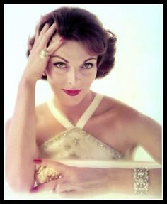 Joanna McCormick wearing Jean Schlumberger's diamond ring and bracelet and 18-karat gold evening minaudiere, photo by John Rawlings, Vogue Nov.1, 1957