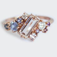 morganite sapphire and diamond cluster ring. One of a kind ring available in 14k rose gold as pictured  #cluster #ombre #rainbow #summer #clusterring #capucinne #baguette #morganite #wedding #paris #london #diamonds #blue #geometric