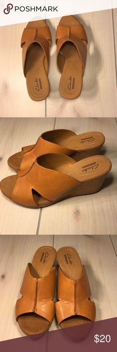 Women's Size 7.5 Clark's Collection Wedges Women's size 7.5 Clark's Collection Tan Wedge Sandals with a 2.5 inch Wedge Heel.  ITEM IS EXACTLY AS PICTURED  ** Bundle this item along with 2 or more items from my closet and save an extra 10% off!  If you have any questions please feel free to comment below or send me a message. Thank you! Clarks Shoes Wedges