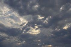 Sun breaking through stormy skies