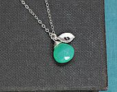 I am in love with this shops work. I think I may have to order this with my sons birthstone and initials