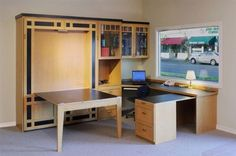 It's a bed, craft table, office. Wow!  I want it.  http://www.closetfactory.com/wall-beds/wall-bed-galleries/flex-rooms/?imgid=4991