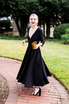 With three-quarter sleeves and a full tea-length skirt, this stunner gives us major mid-century vibes; the plunging neckline is a sexy, modern accent.Only available at BHLDN Christmas Wedding Guest Outfits, Holiday Outfits, Winter Outfits, Black Women Fashion, Womens Fashion, Fashion Beauty, Gothic Fashion, Black Dress Outfits, Dress Black