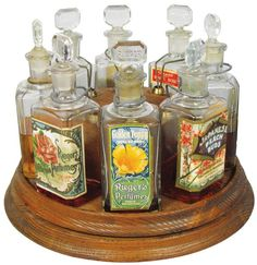 Reiger's Perfume Store Display. Eight different bottles with original paper labels, ground glass and embossed lids.