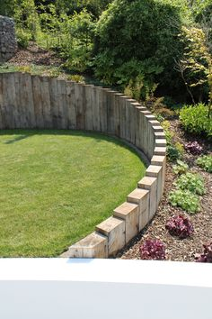 Vertical sleepers creating a lovely staggered wall with planting. Vertical sleepers creating a lovely staggered wall with planting. Back Garden Landscaping, Landscaping Retaining Walls, Sloped Garden, Garden Steps, Garden Edging, Side Garden, Sloped Backyard, Back Gardens, Small Gardens