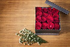 Red rose in black gift box on wood table by Sumrit Chaleowpanya on 500px