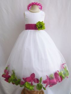 Beautiful flower girl dress for a pink and green wedding.