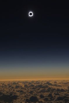 The recent solar eclipse seen from a plane. Amazing!