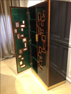 Cabinet with exotic wood and gold leaf