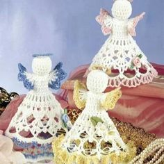 6 beautiful angels are included in this pattern each is stitched angels dt1010fo