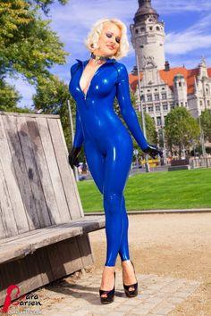 Lara Larsen in blue latex catsuit in public