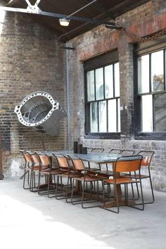 Industrial dining room - red bricks and windows