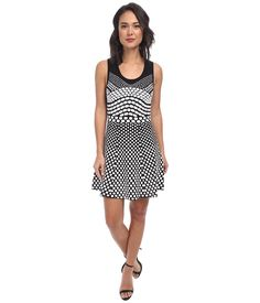 Take your fashion to a unique level with the Nicole Miller dress. ; Dress flaunts prim dots throughout. ; Scoop neckline. ; Slip-on construction. ; Unlined. ; 63% viscose, 37% nylon. ; Dry clean only. ; Imported. Measurements: ; Length: 36 in ; Product measurements were taken using size SM (US 4-6). Please note that measurements may vary by size.