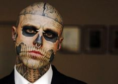"Rick Genest, Canadian artist, actor, and fashion model aka Rico the Zombie Boy, Before he had any tattoos, Genest was diagnosed with a benign brain tumor, he then started living ""an anarchistic lifestyle"" Tattooed himself as a living skeleton"