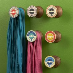 Scarf hooks from empty wooden thread reels. But I have so many silk scarves. This would take up most of a wall...