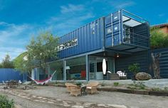 This shipping container home in Spain was constructed in an L-shape form. Created using four recycle... - James & Mau Arquitectura