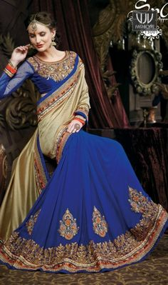 Attractive Blue And Gold Pure Banarasi Designer Saree Attractive blue and gold pure banarasi designer saree featuring embroidery, zari, stone, resham, lace and patch border work.