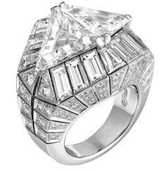 Cartier Biennale Ring in platinum with two triangular-shaped diamonds of 3.2 and 3.03 carats, baguette-cut diamonds, and brilliants.