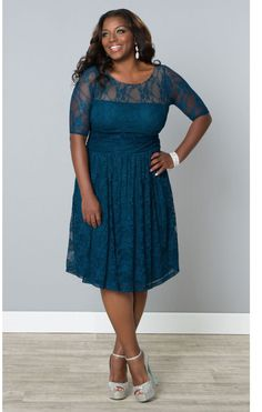 Luna Dress in Teal This versatile plus size dress is sure to become your go to for office parties, dressy occasions and a night on the town! A classic plus size cocktail dress in a shape that flatters every body type. #slimmingbodyshapers