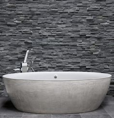 Bathtub With A Combination Of White Plasticryl Inside And Beige Concrete  Finish Outside With Polished Chrome