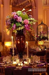 Grand centerpieces filled with calla lilies, hydrangeas and lotus pods among many others.