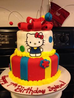 Red, Blue, and Yellow Hello Kitty Cake
