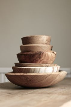 Wooden bowls maybe with sheets of moss and/or succulents with a candle?