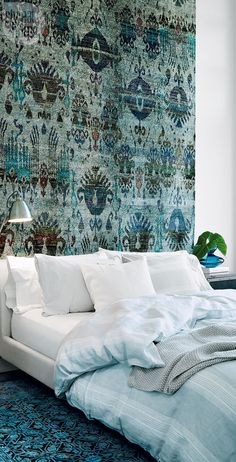Vivid hues and intricate motifs – delivered via the rugs on the wall and floor – give the master bedroom an exotic feel and speak to the style elements Jamie loves best. | Image: Michael Graydon Styling: Stacy Begg