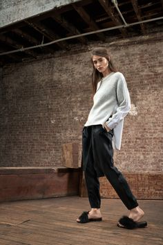 Tibi Fall 2015 look 12. Cozy up throughout the fall in sophisticated loungewear. An oversized knit, wool jersey joggers, fuzzy slides are weekend essentials.