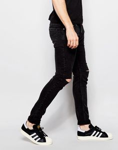 Shop Pull&Bear Super Skinny Jeans With Rips In Washed Black at ASOS.