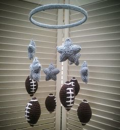 Super cute nursery or kids room decor featuring six stuffed, crocheted footballs and six stuffed baby blue knit stars. They are hung with fishing line from a wooden hoop that is wrapped in the same baby blue yarn for a soft look.   Crafted from all original designs, in a clean, smoke-free environment.  https://www.etsy.com/listing/208050667/baby-boy-crib-mobile-football-stars