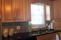-with-oak-wood-kitchen-cabinet-along-with-black-granite-counter-tops ...