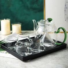 You cannot go past our Farrah Green Steam Glass Teapot Sets. Redesign your kitchen and dining setting with one of our four complete sets, or create your own by choosing each individual piece. Choose your favorite glass teapot, then add cups, or choose a complete set. With their simple yet elegant Nordic design, each teapot varies in shape, size, water capacity and color.
