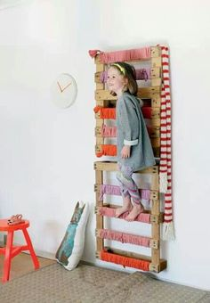 mounted pallets ladder for play room. My kids would climb to the top so a mat would help with safety.