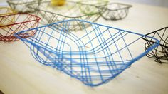"""Tartan, a wire basket designed by """"mute"""" and exhibited at Design Tide Tokyo."""
