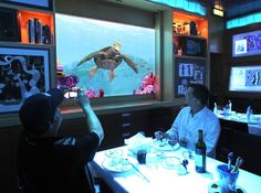 Crush, the turtle from Finding Nemo, entertains diners at he Animator's Palate restaurant, on the official christening cruise of the Disney Dream, from Port Canaveral, Fla., to Castaway Cay, Bahamas, Thursday, Jan. 20, 2011.